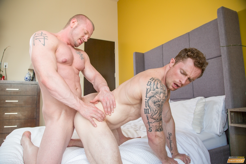 two big muscle men fucking on a bed